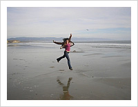 Person Jumping on Beach